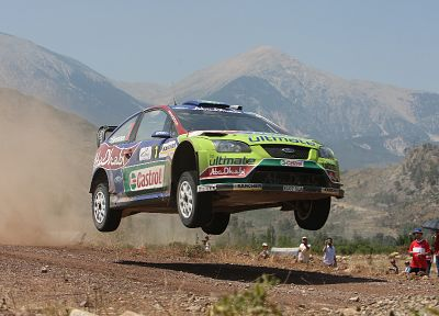 mountains, cars, jumping, dust, rally, airborne, racing, Ford racing, races, rally cars, offroad, gravel, Ford Focus WRC, racing cars, jump - desktop wallpaper