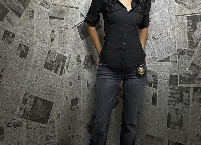 brunettes, women, jeans, actress, police, Angie Harmon, newspapers - desktop wallpaper