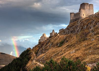 sunset, mountains, clouds, landscapes, nature, Sun, castles, ruins, skylines, grass, fields, rainbows, skyscapes - related desktop wallpaper