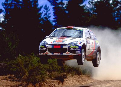 cars, dust, rally, racing, Colin McRae, races, rally cars, gravel, Ford Focus WRC, racing cars, rally car, jump - related desktop wallpaper