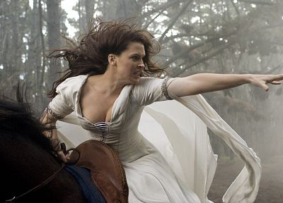 brunettes, women, forests, Bridget Regan, Legend Of The Seeker, cleavage, outdoors, horses, angry, action, reaching out, riding, horseback riding, girls with horses - random desktop wallpaper