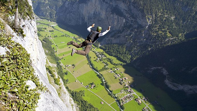Switzerland, extreme sports, BASE Jumping, arms raised - desktop wallpaper