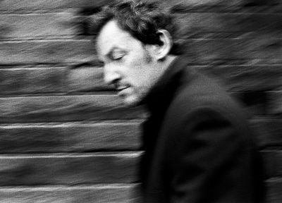Bruce Springsteen, grayscale, motion blur, brick wall, musicians, Danny Clinch - random desktop wallpaper